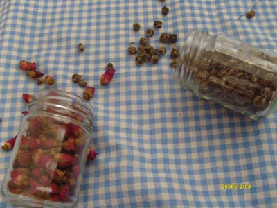 Dried rosebuds and tea leaf balls.